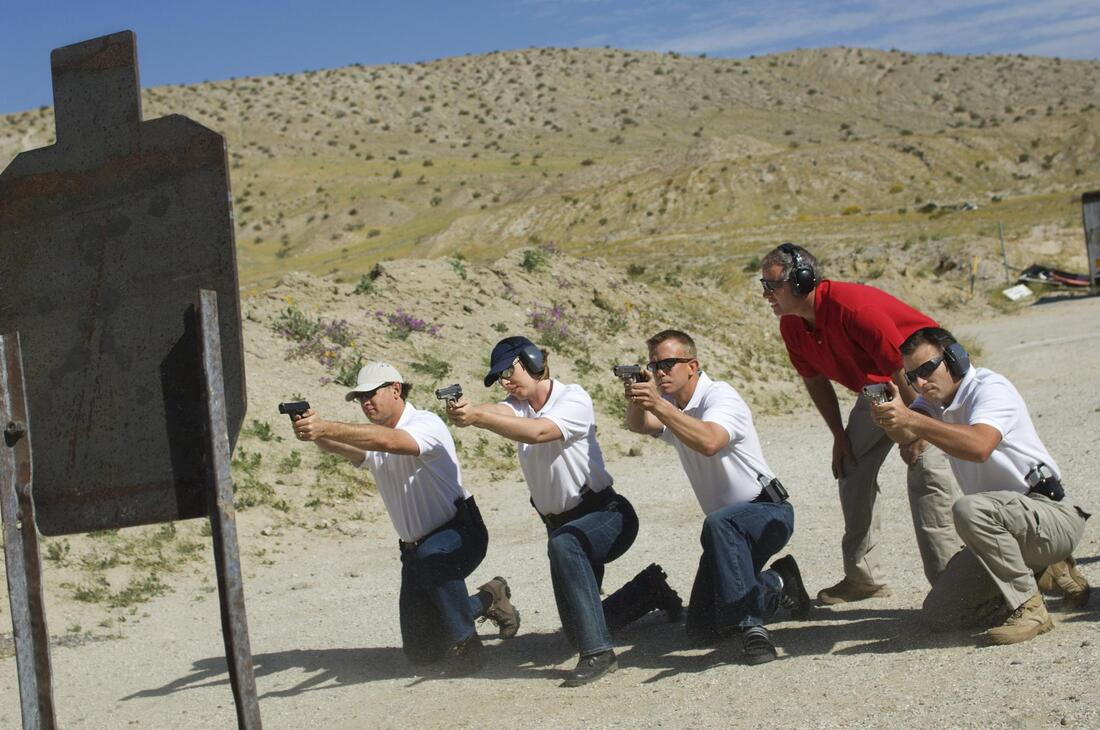 All 4 men's getting Pistol Classes